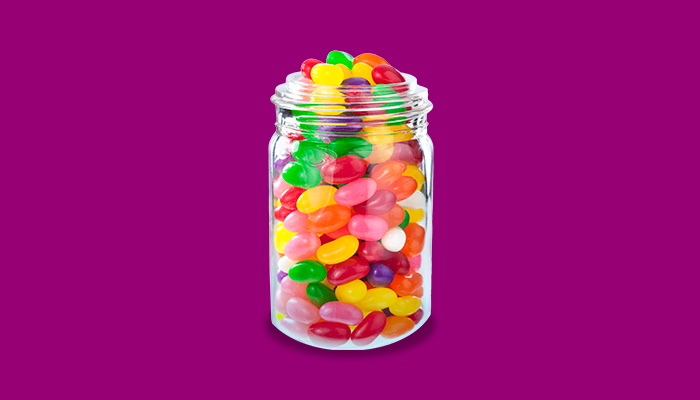 Jar full of different coloured jelly beans