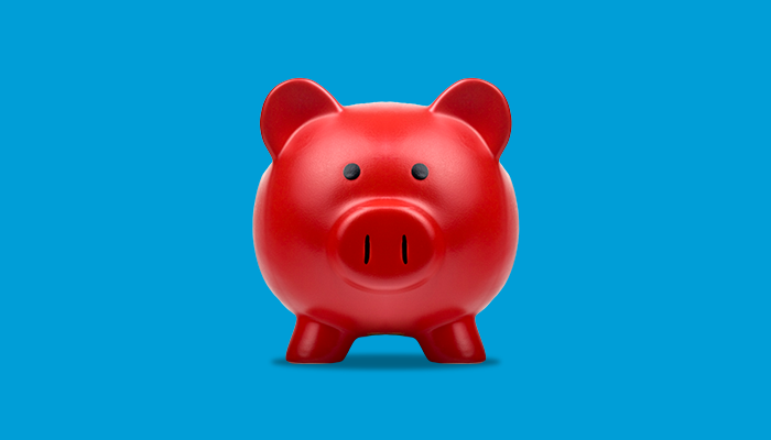 Red piggybank for saving coins